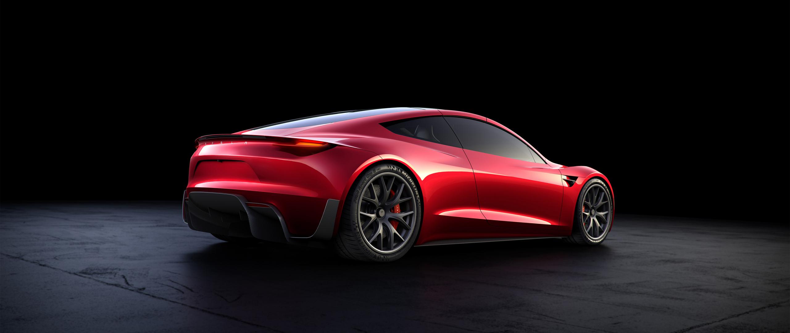 download 2560x1080 wallpaper tesla roadster, red car, rear view, 4k