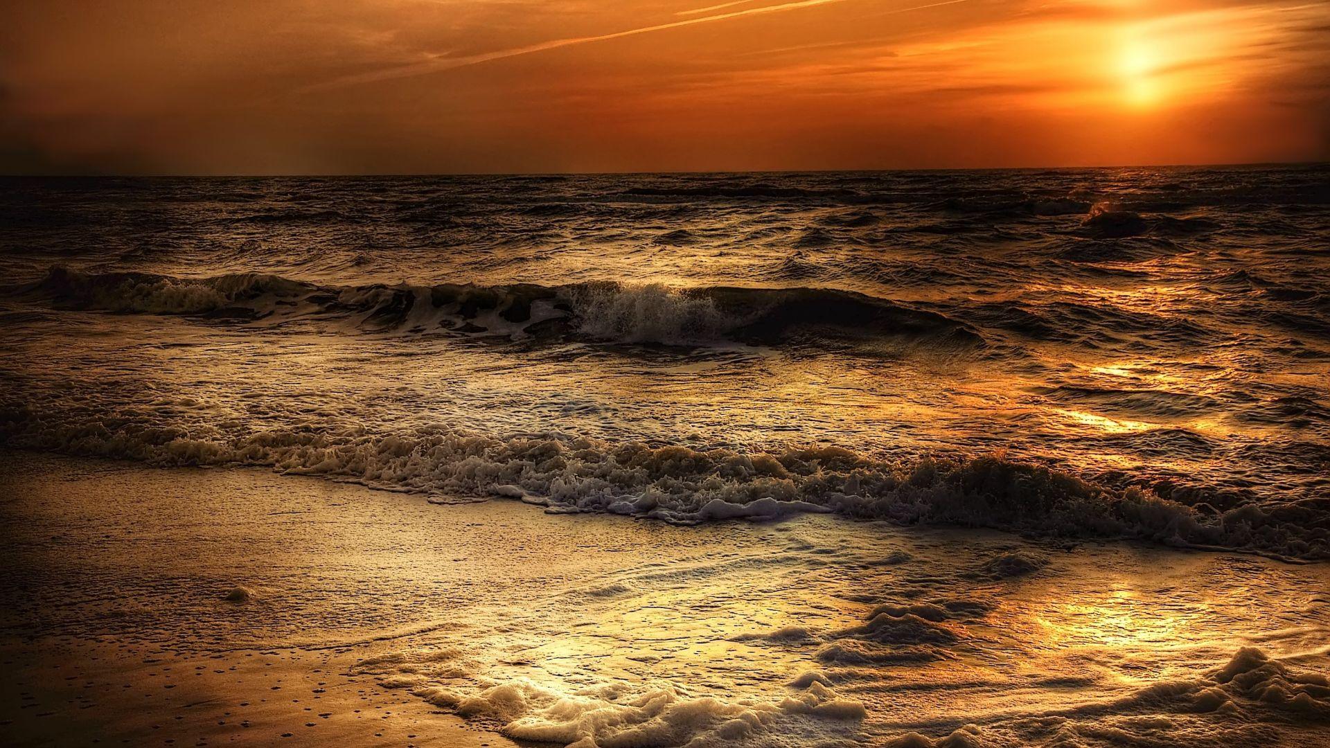 sunset sea waves sea beach sand