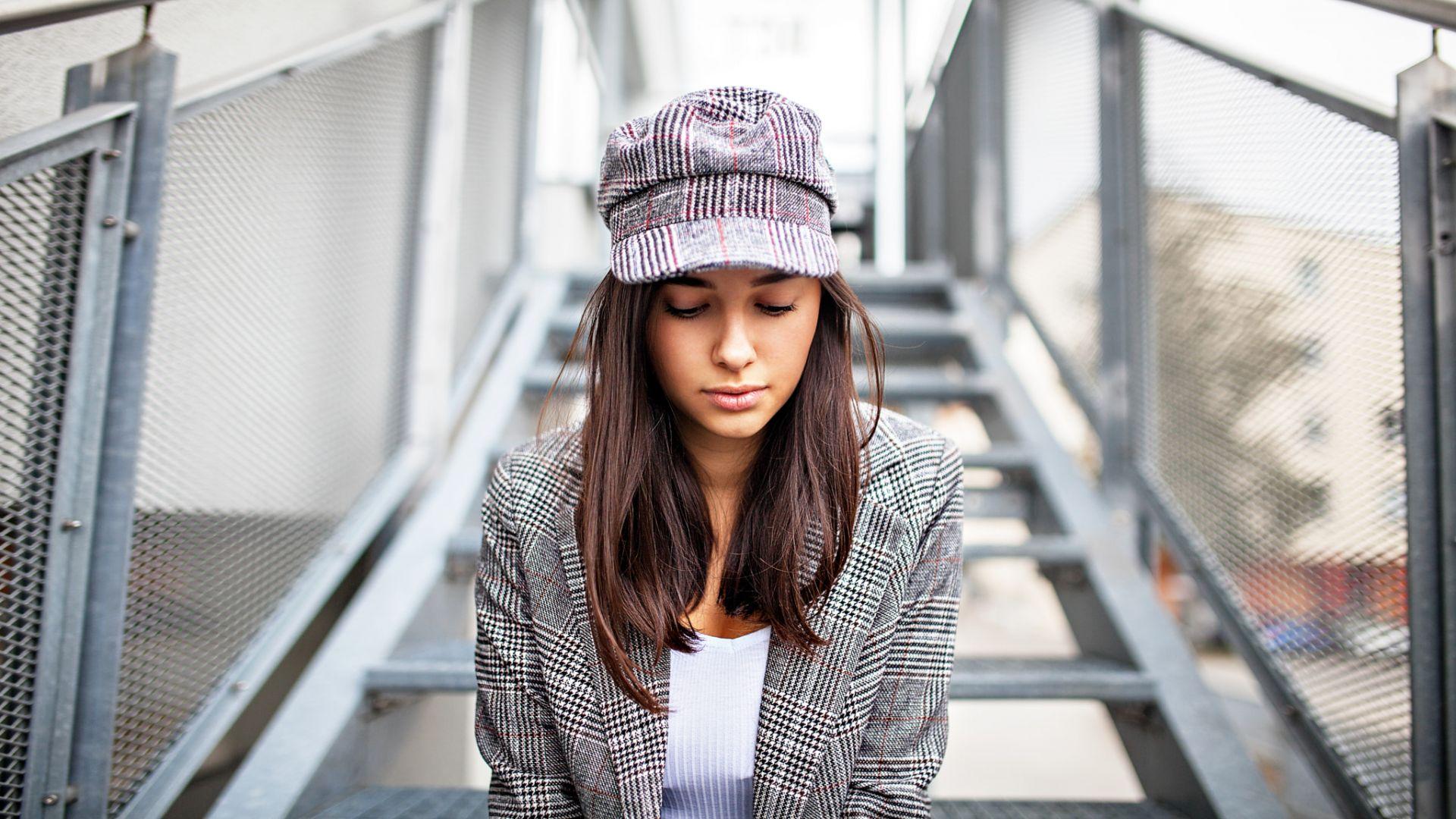 Sitting on stairs, girl model, brunette