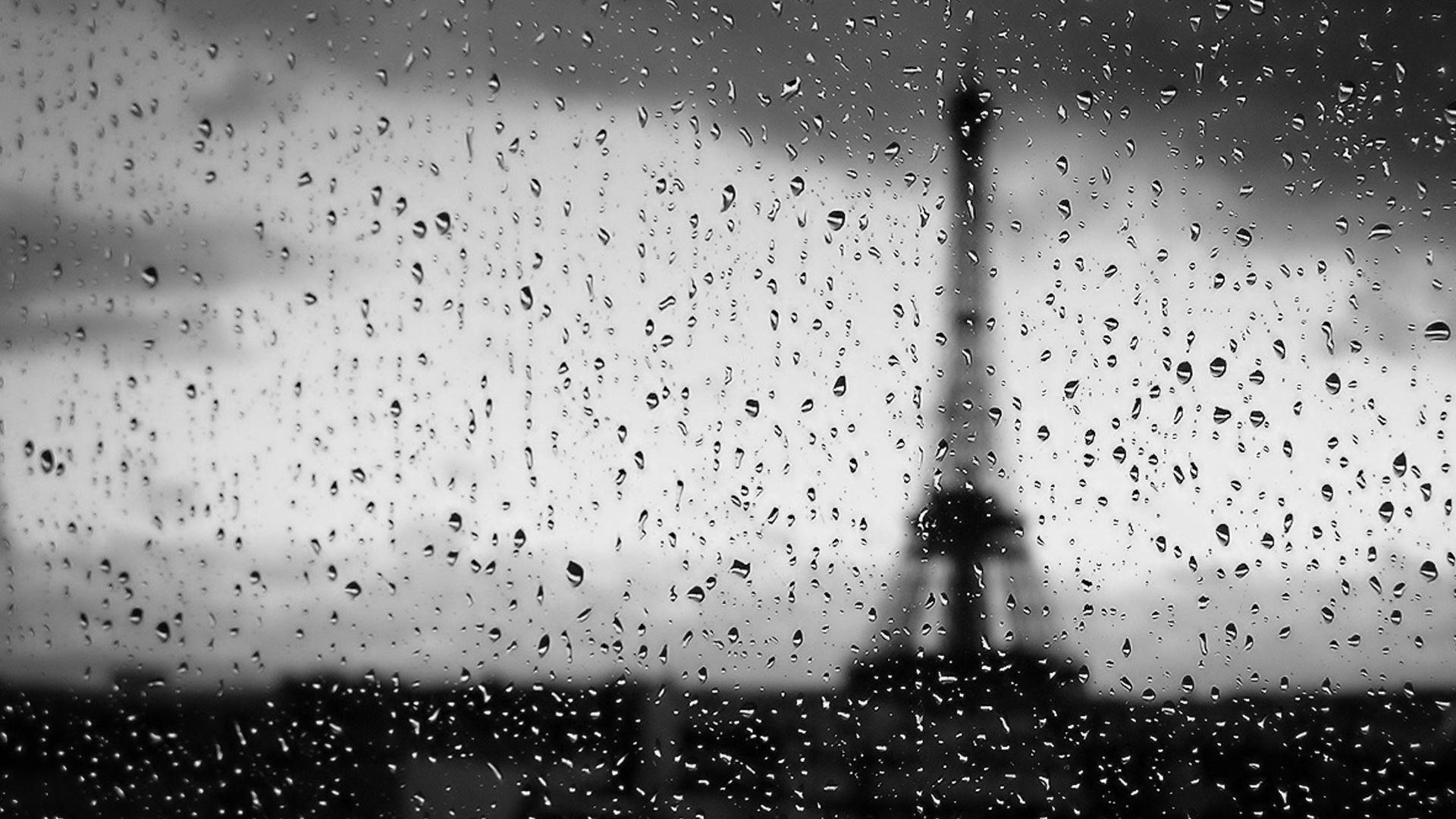 Wallpaper Eiffel tower of Paris through water drops window surface