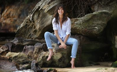 Smile. Georgia Fowler fashion model, sit, beach