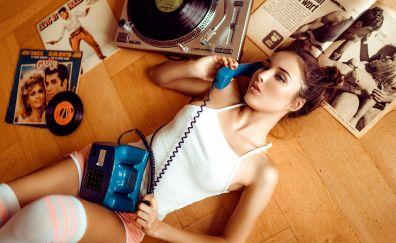 Lying down, girl model, talking on telephone