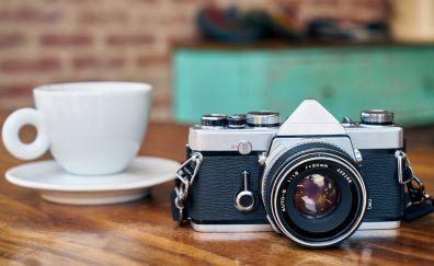 Camera, coffee cup, blur