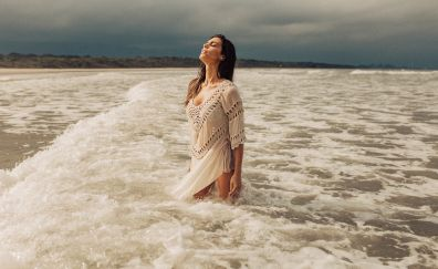 Beach, sea waves, girl model, closed eyes