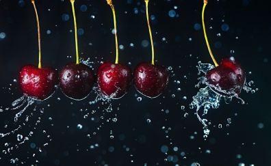 Red cherries in water