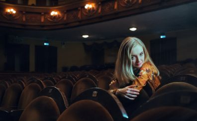 Blonde girl, beautiful, sitting, theatre