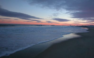Skyline, sunset, soft sea waves, foam, beach