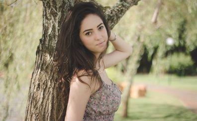 Girl model, leaning to tree trunk, outdoor, park, brunette