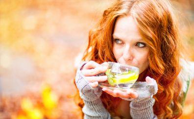 Red head, girl drinking tea