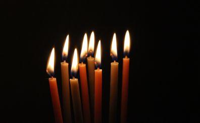 Candles light, dark