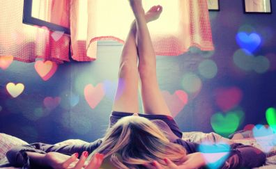 Girl, lying on bed, legs up