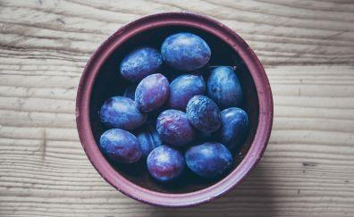 Plum fruits in dish