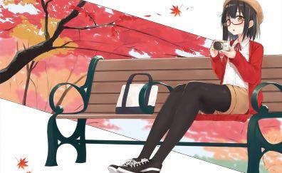 Cute girl, sitting on bench, garden