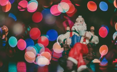 Santa Claus toy and bokeh Christmas lights