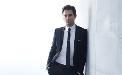Matt Bomer, leaning to wall, suit