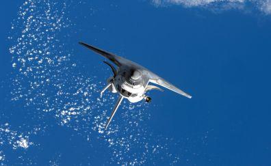 Space shuttle in sky