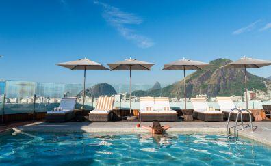 Girl in rooftop pool porto bay rio