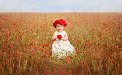 Cute baby girl in poppy field