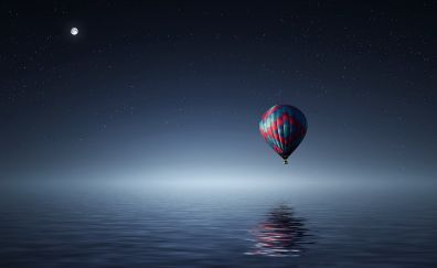 Hot air balloons over sea in night