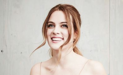 Smiling face of Riley Keough, celebrity