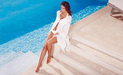 Swimming pool, red head, girl model, bikini