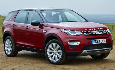 Land rover discovery red car