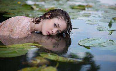 Asian beautiful girl model in pond