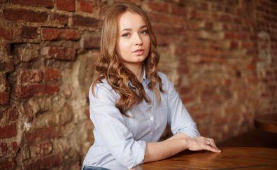 Red head, bricks wall, girl, sit