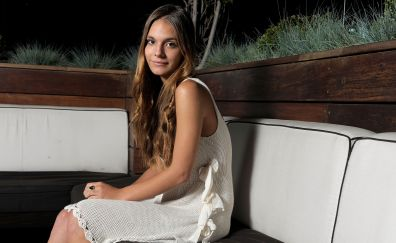 Caitlin Stasey, celebrity, sitting on sofa