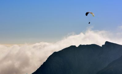 Paraglider flying sky mountains