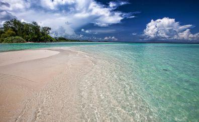 Tropical beach, sand, sea waves, blue sea, skyline, clouds