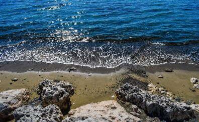 Beach, sunlight, blue sea waves, rocks
