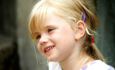Cute baby girl's smiling face, blonde