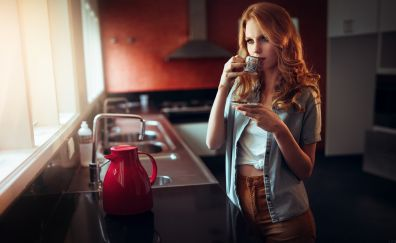 Red head woman in kitchen