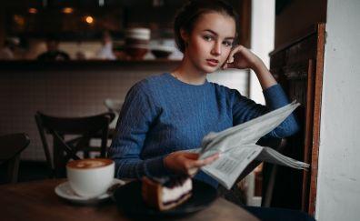 Julia Tavrina, model, reading news paper