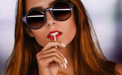 Women, sunglasses, lollipop