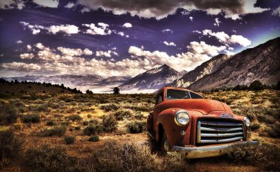 Vintage car and mountains