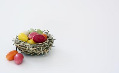 Easter nest, eggs, candies, celebrations