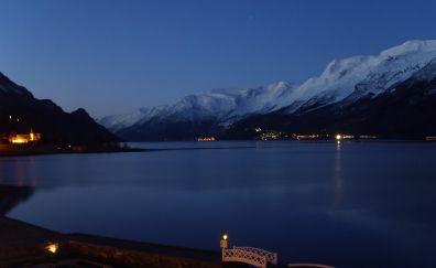 Mountains, city, lake in night