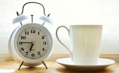 Alarm clock, coffee cup, morning