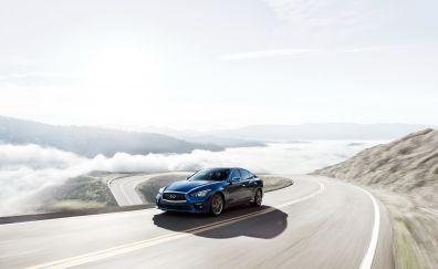 Infiniti Q50 luxury car on road
