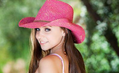 Girl model wears pink hat