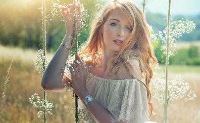 beautiful blonde girl on swing