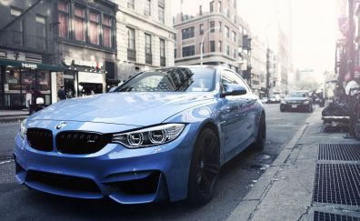 Blue BMW car on City street