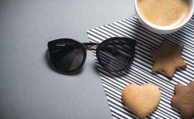 Sunglasses, cookies, coffee cup