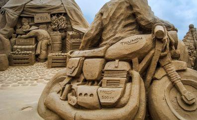 Sculpture of sand of bike wallpaper