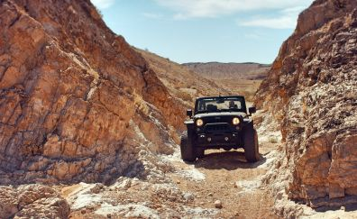 Jeep SUV in rocks desert