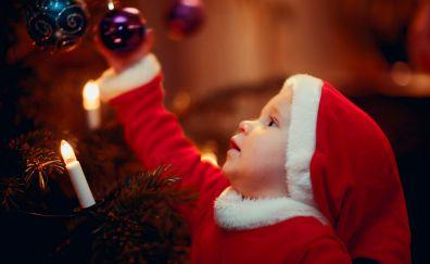 Cute Santa decorating the Christmas tree