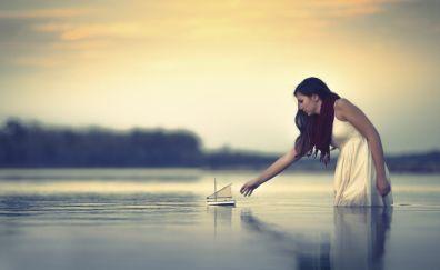 Woman, lake, paper boat