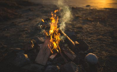 Wood Fire, rocks and sunset